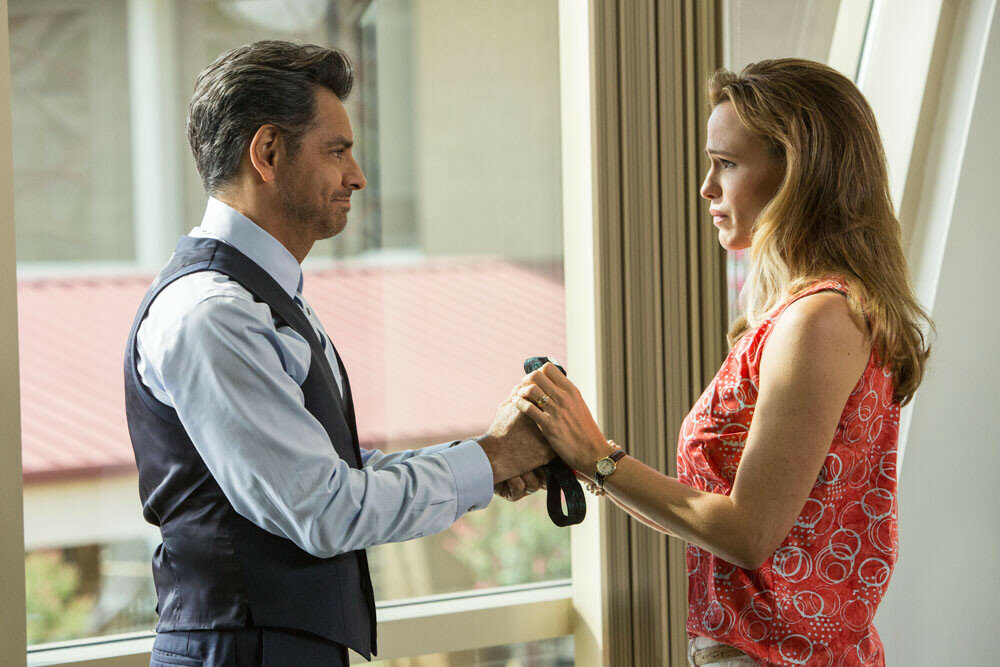 Dr. Nurko (EUGENIO DERBEZ) hands his Elmo tie to Christy (JENNIFER GARNER) as a memento now that Anna seems to be healed in Columbia Pictures'  MIRACLES FROM HEAVEN.