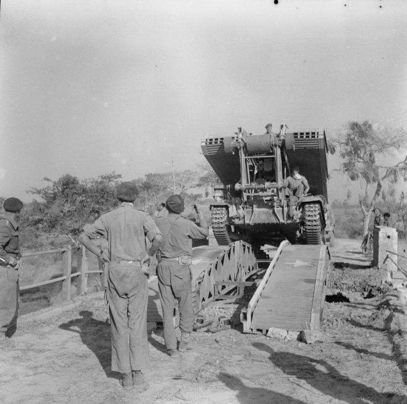 A Valentine bridgelayer of the 3rd Independent Bridge Building Company, Royal Armoured Corps, crosses a scissors bridge near Meiktila, 28 March 1945