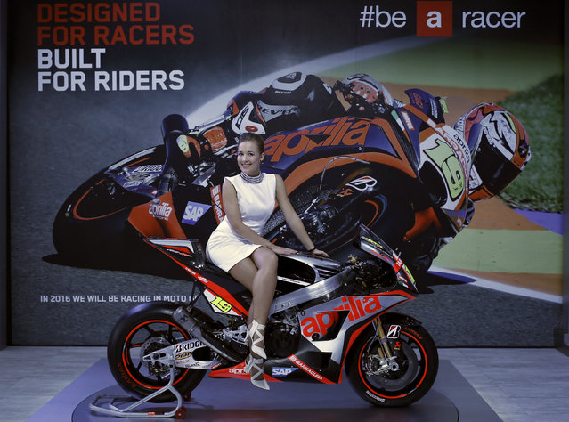 A model poses on Aprilia motorcycle displayed at the Indian Auto Expo in Greater Noida, on the outsk
