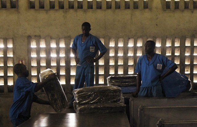 Men work at a rubber factory in Songon village, north of Abidjan January 25, 2016. (Photo by Luc Gna