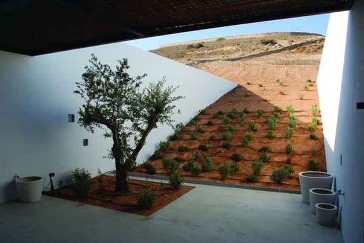 Дом под пустыней практически незаметен и потребляет мало электричества. Дом в водонапорной башне (Ан