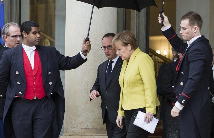 Меркель в гостях у Олланда.jpg