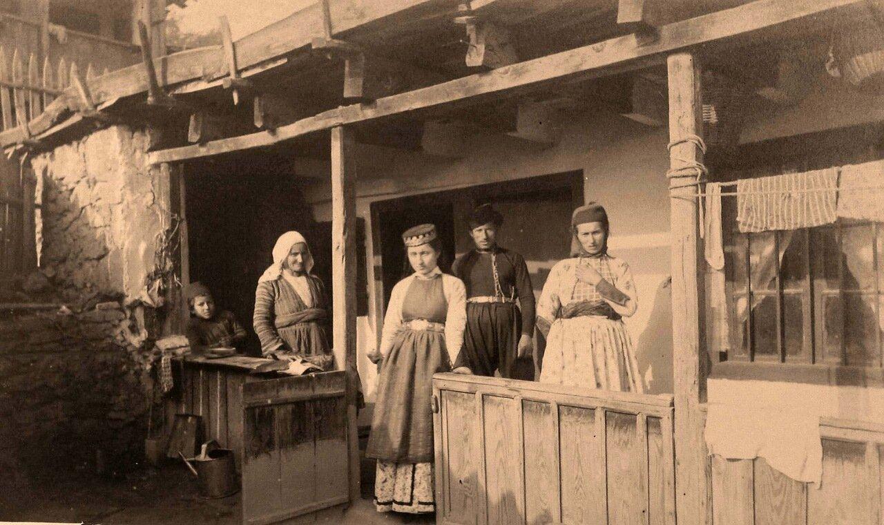 55. Семья крымских караимов в национальных костюмах у входа в дом