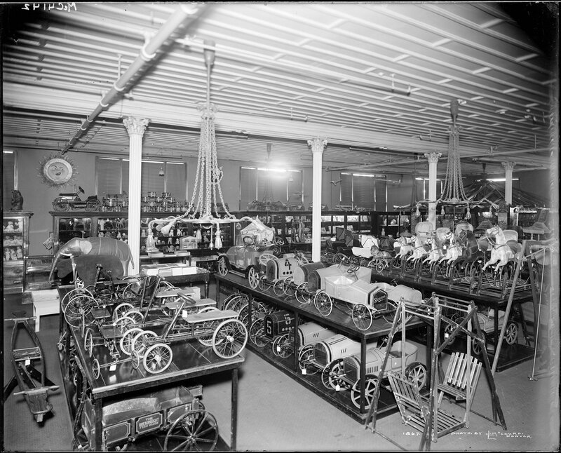 Interior view of a children's toy store in Denver, Colorado; shows display of children's riding toys, between 1900 and 1920