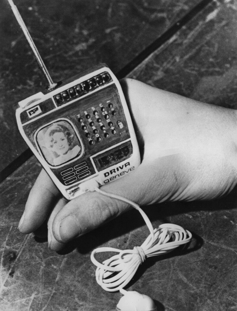 A watch, made by Driva Geneve of Switzerland, incorporating a TV, radio and calculator, 20th February 1976. The lead connects to a battery kept in the pocket.jpg