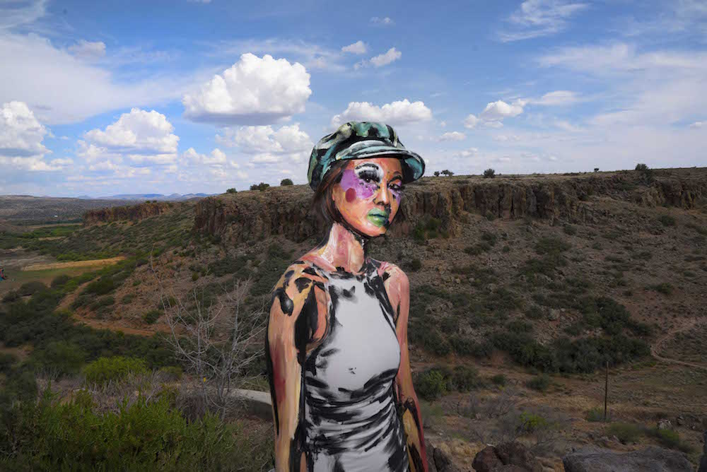 Alexa Meade's live painting during FORM Arcosanti, base makeup by Josephine Lee