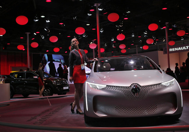 A model poses next to a Renault Eolab concept car on display at the Indian Auto Expo in Greater Noid