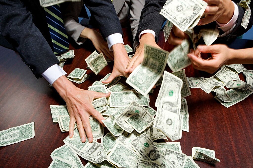 Businesspeople grabbing money