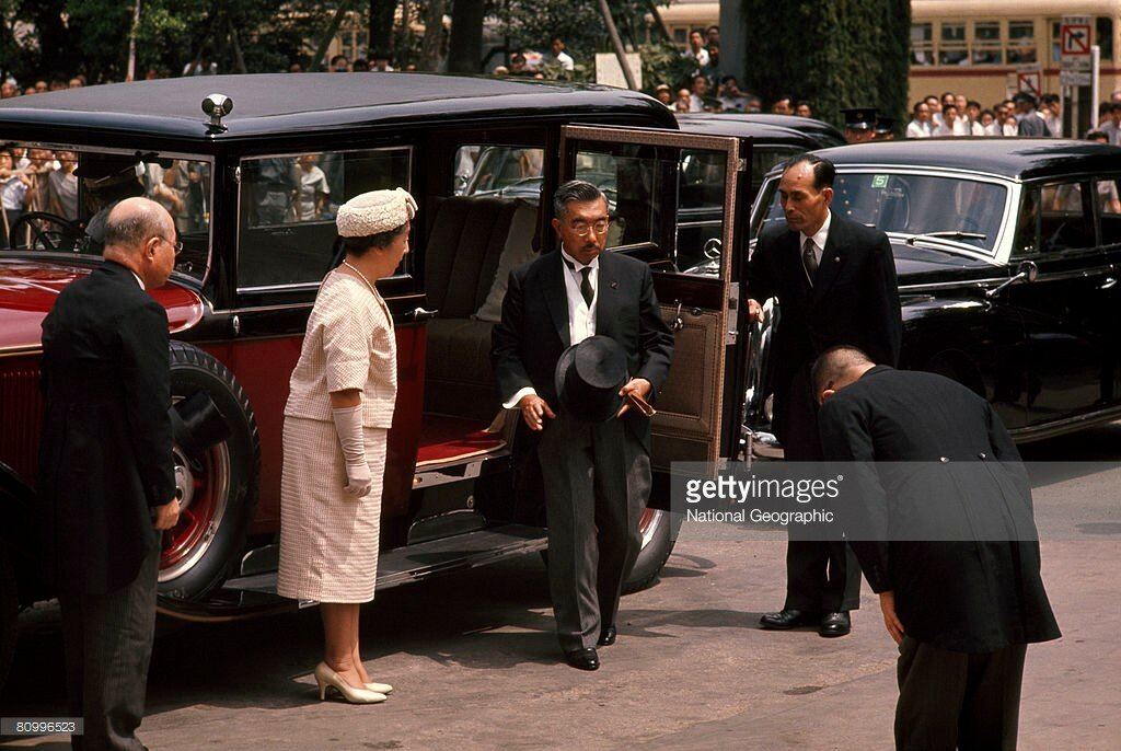 1963 Empress and Emperor of Japan exit a car to attend a memorial, Tokyo.jpg