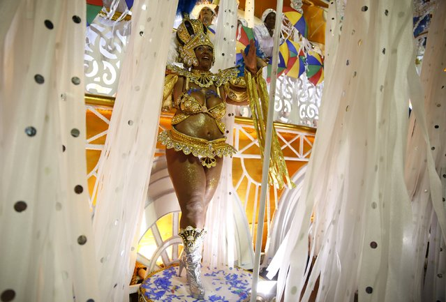 A reveller of Vila Isabel samba school performs during the carnival parade at the Sambadrome in Rio
