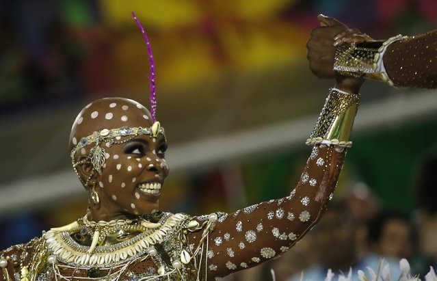 Performer from the Mangueira samba school parades during carnival celebrations at the Sambadrome in