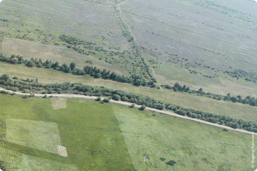 Вид из иллюминатора набирающей высоту сессны 208, вылетевшей из аэропорта Байкал, окрестности г. Улан-Удэ