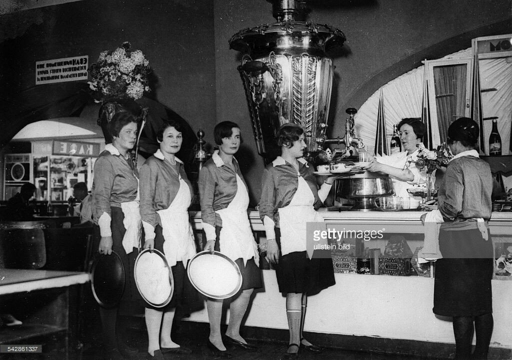 1929 waitresses wait at the bar next to a large samovar in a department store.jpg