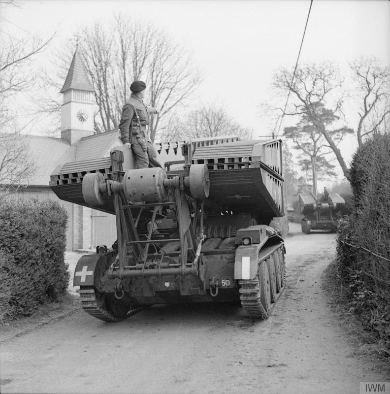 "Valentine bridgelayer passing through a village during Exercise ""Spartan"", 6 March 1943."