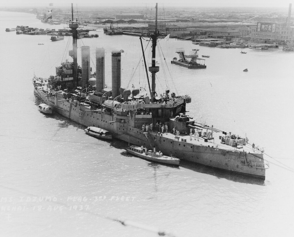 IDZUMO (Armored cruiser, Japanese, 1899) View taken on 18 August 1937. Note mattress padding around machine gun and control positions, and boats tied up alongside. View probably taken from USS AUGUSTA (CA-31) as she was on her way up river to moor off the bund. IDZUMO was, at the time, the Third Fleet flagship, Vice Admiral Kiyoshi Hasegawa, Commander in Chief.