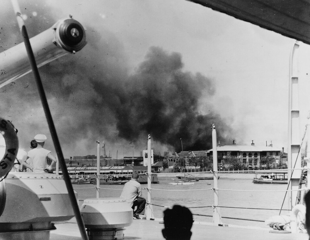 USS AUGUSTA (CA-31) Crew watches the progress of fire at Pootung Point, circa August 1937, while at Shanghai, China.