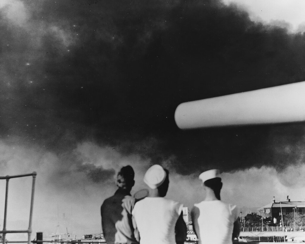 USS AUGUSTA (CA-31). Sailors view smoke from Pootung Point fire, while their ship was moored in the Whangpoo River off the Shanghai (China) Bund, circa August 1937.