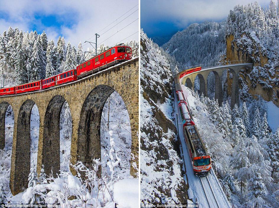 Красные вагоны поезда «Бернина Экспресс», следующего по виадуку высотой 65 метров, придают заснеженн