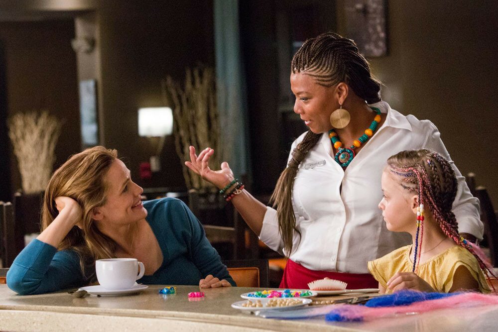 Angela (QUEEN LATIFAH) braids Anna's (KYLIE ROGERS) hair as Christy (JENNIFER GARNER) watches in Columbia Pictures' MIRACLES FROM HEAVEN.
