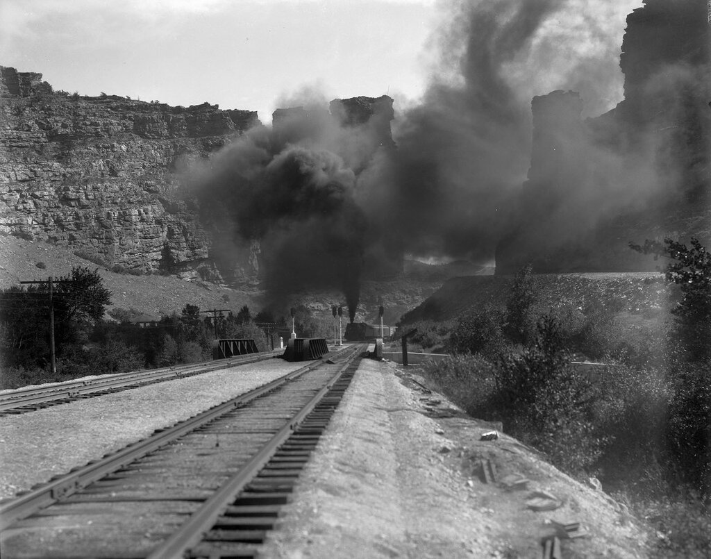 Denver and Rio Grande Western Railroad tracks, bridge, and signals are at Castle Gate, Utah, between 1927 and 1930