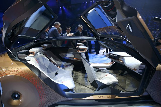 """People look at the interior of the BMW """"Vision Next 100"""" concept car during centenary celebrations a"""