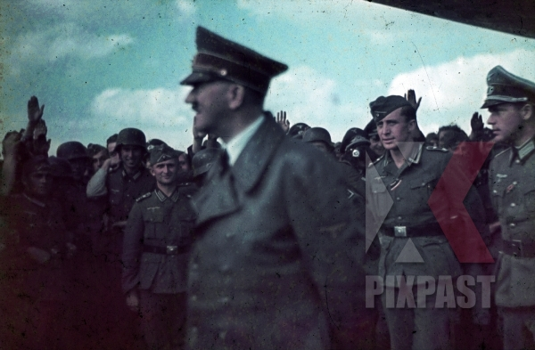 stock-photo-ww2-color-adolf-hitler-visiting-troops-in-ukraine-1941-with-body-guards-and-security-helmet-7909.jpg