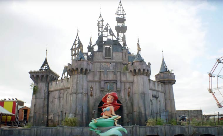 Banksy has just released a promotional video for Dismaland, his satirical amusement park