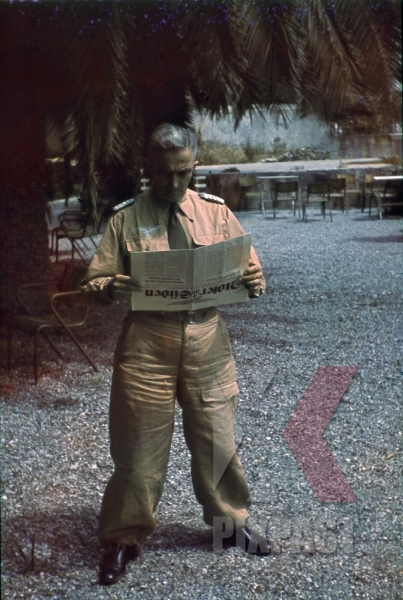 stock-photo-ww2-color-1943-sicily-luftwaffe-tropical-officer-reading-adler-sud-newspaper-8476.jpg