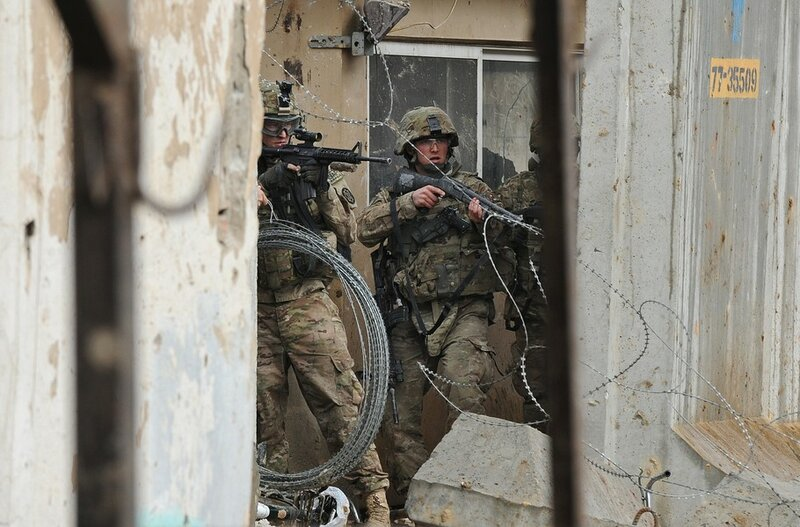 A US soldier wields his assault rifle (L
