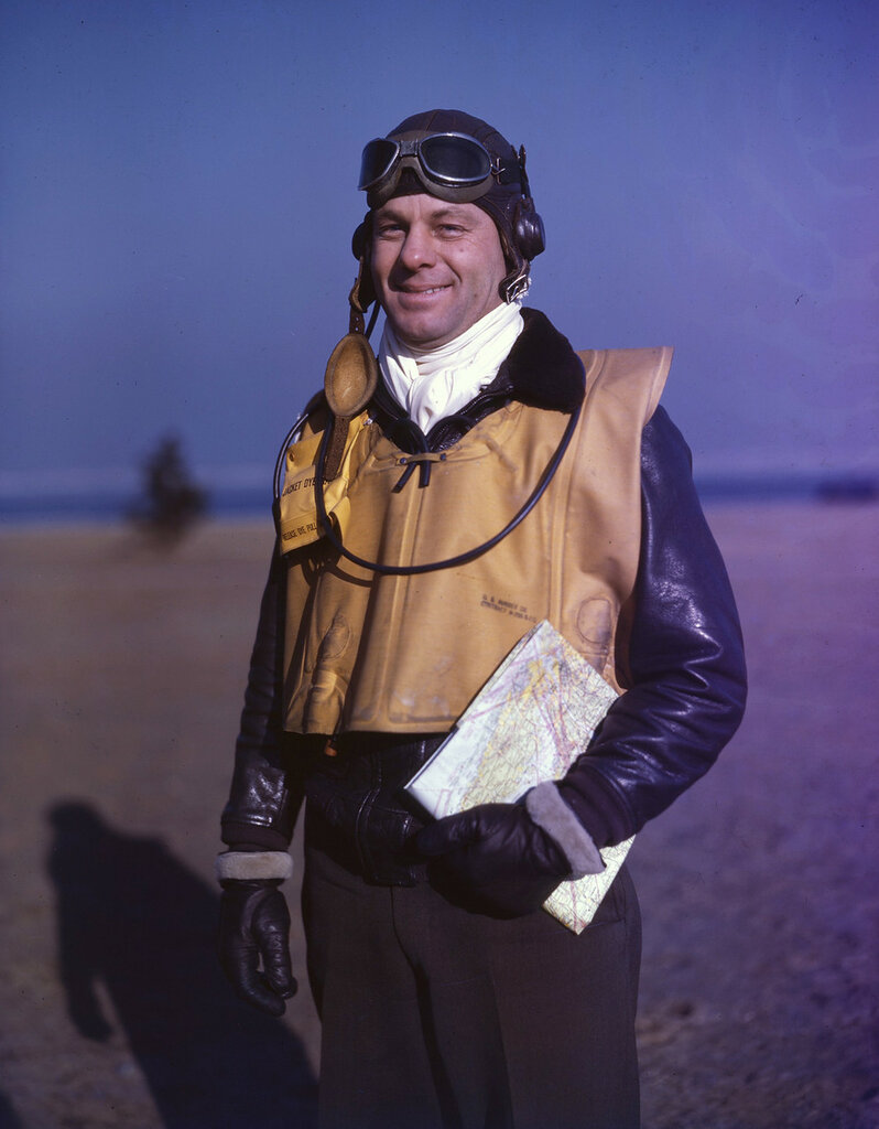 U. S. Coast Guard Lt. Commander F.G. Wild wearing heavy winter flight gear, yellow life preserver, with dye marker on shoulder, 1943.