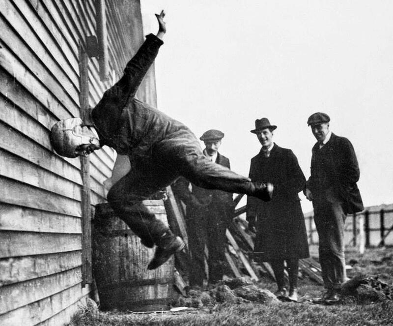 1912 - Testing football helmets.jpg