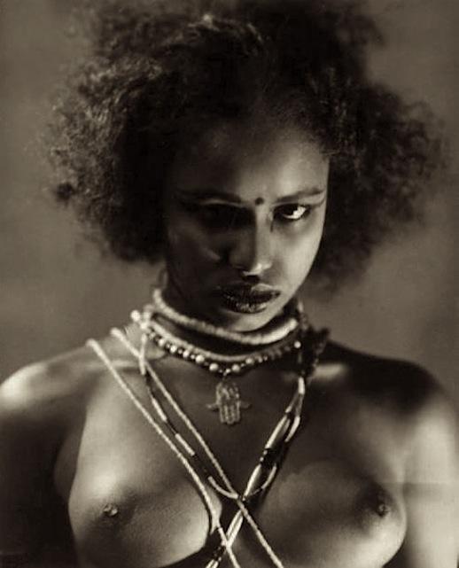 Portrait of topless woman, Egypt, circa 1930.jpg