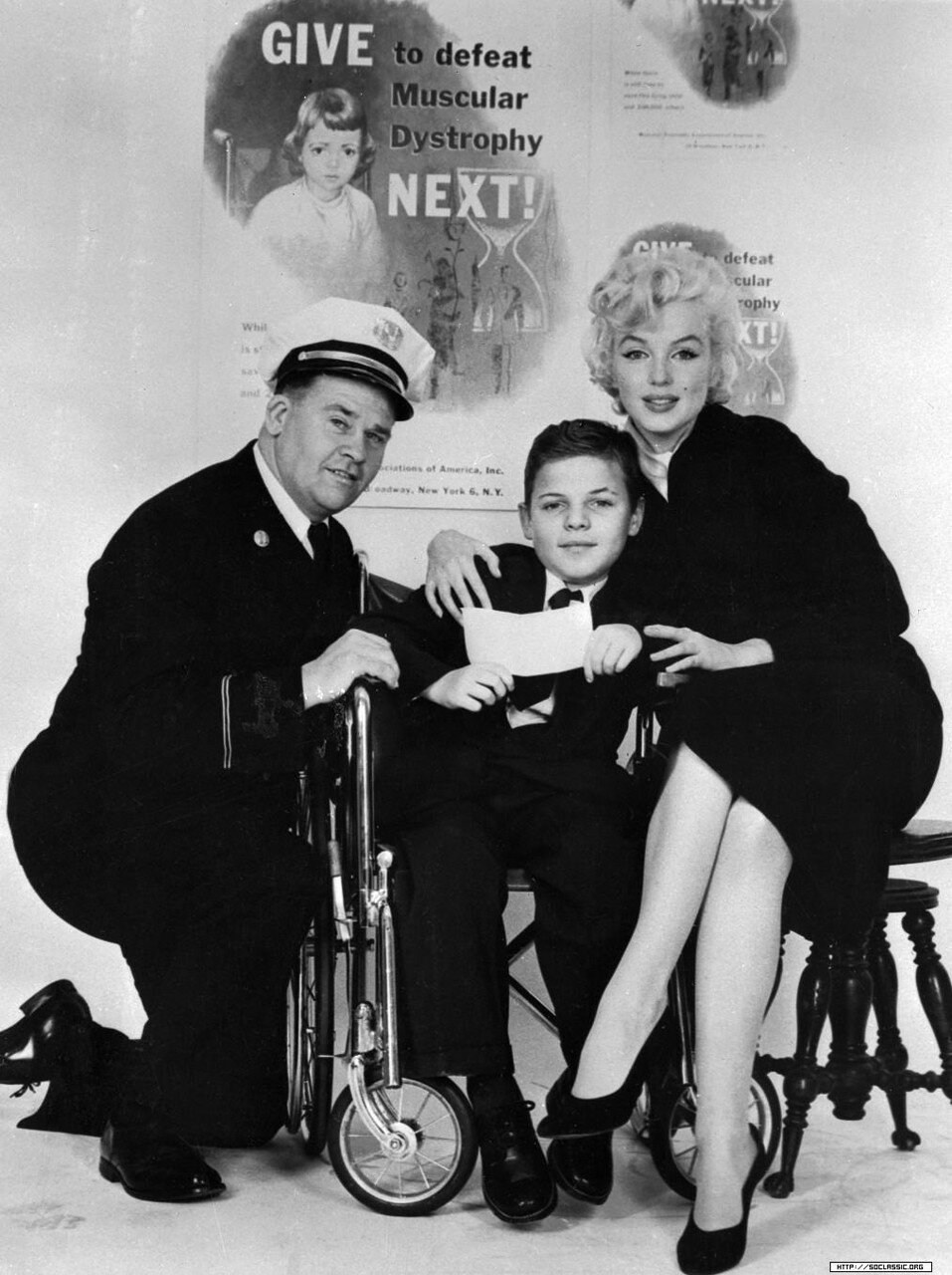Marilyn Monroe Sitting with Muscular Dystrophy Sufferer
