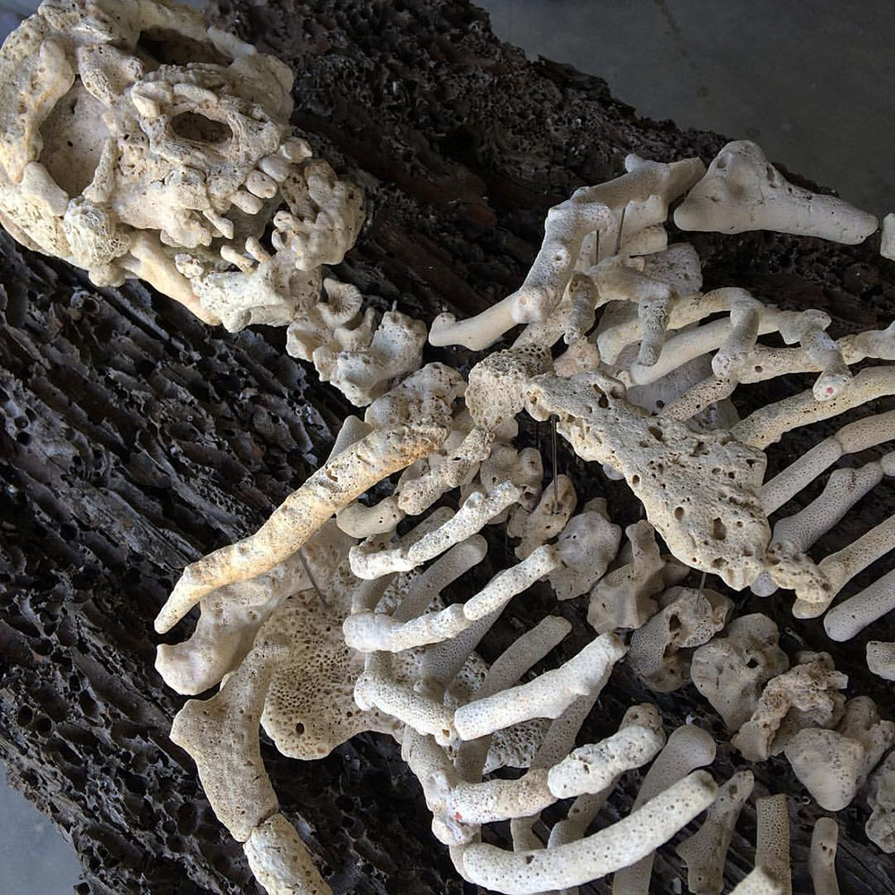 Human Skeletons Assembled with Found Coral by Gregory Halili