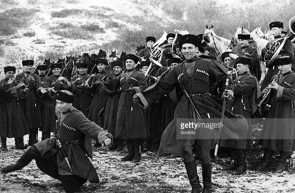 Soviet red army cossacks enjoying a little downtime by giving a traditional dance performance, february 1938.jpg