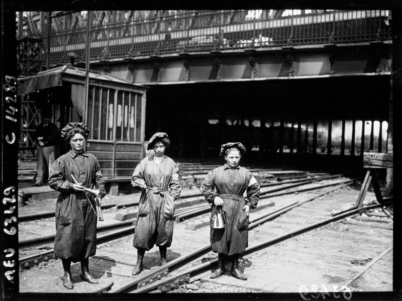 Women grease and inspect the signals Gare du Nord Paris France