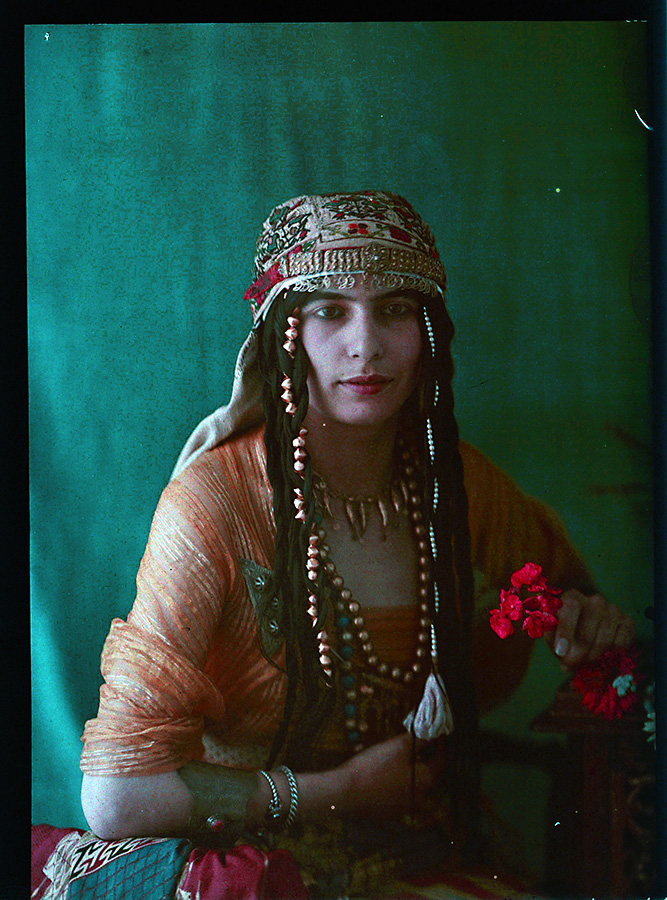 Middle Eastern Woman Holding Flowers.jpg