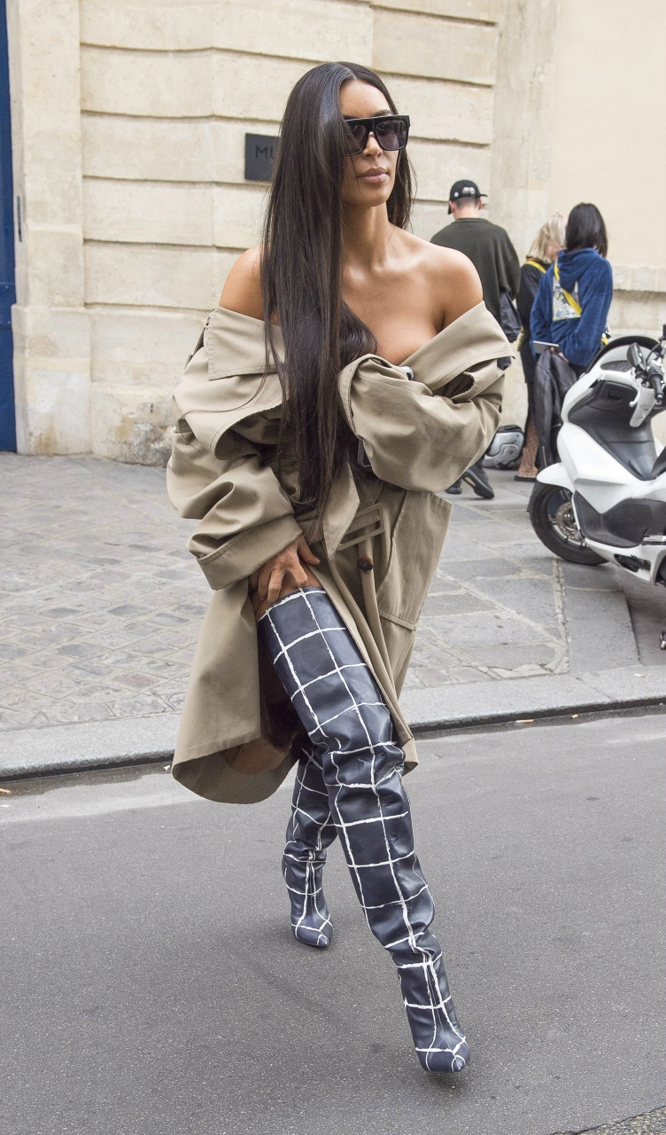 Kim Kardashian seen leaving the Mugler offices in Paris. She was wearing some almost waist high boots!