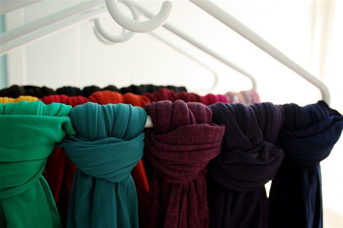Roll clothes and scarves for packing, or storing for the winter.