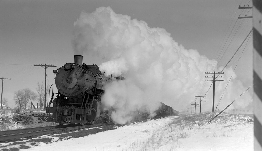 Chicago, Burlington & Quincy train, engine number 5082 and engine number 5629, east of Derby, Colo., March 11, 1951