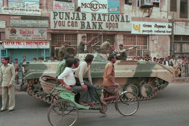 Tank Rolling Through City Street