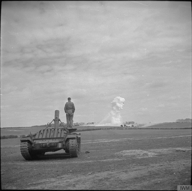 Flame mortar fitted to Valentine tank chassis, firing phosphorus bombs during Petroleum Warfare Department trials, Barton Stacey, 20 April 1944.