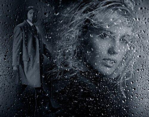 Она стояла у окна лил дождь смывая