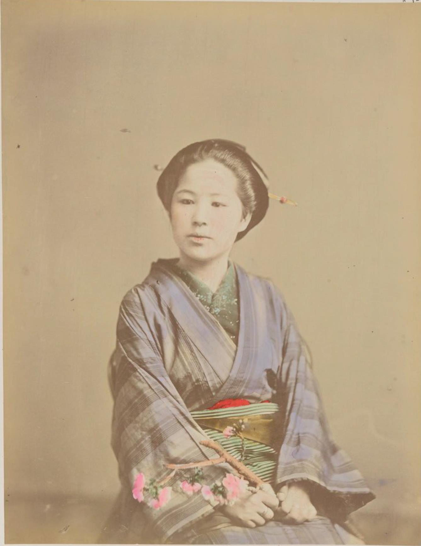 Женщина с веточкой вишни
