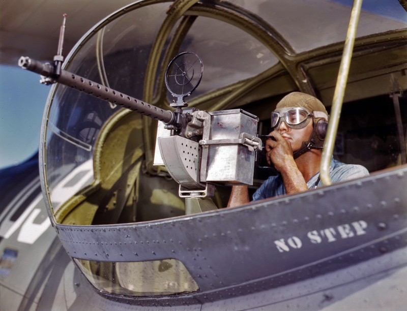 howard_hollem_naval_air_base_at_corpus_christi_texas__jesse_rhodes_waller_aviation_ordnance_mate_third_class_tries_out_a_30_caliber_machine_gun_he_has_just_installed_in_a_navy_plane_1942.3v6ouwhuyk8wkwk0okk0oo.jpeg
