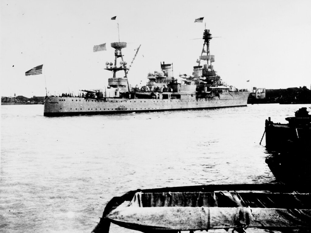 USS AUGUSTA (CA-31). View taken off the Shanghai bund at Shanghai, China, being moved into position at the foot of ~Man of War~ row, during the Sino-Japanese hostilities there, 18 August 1937. Note American flags at fore, gaff, and flagstaff. Ship was then the flagship of Admiral H.E. Yarnell, USN, CINCAF.