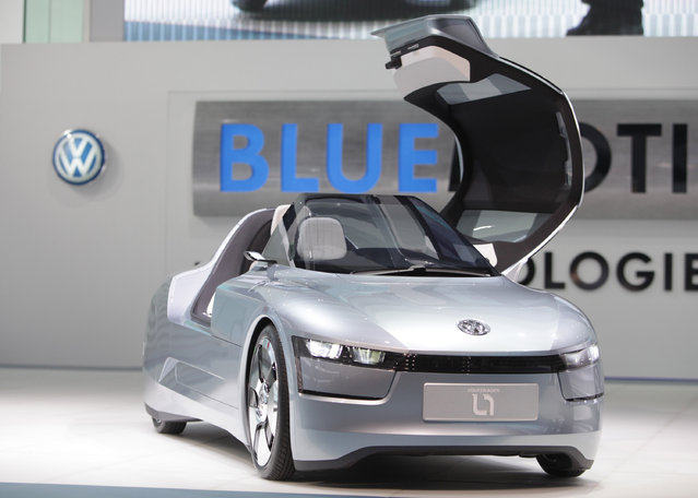 """The one-litre concept car """"L1"""" of German car manufacturer Volkswagen is on display during the media"""