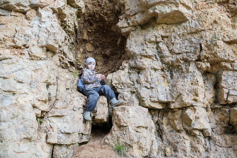 boy sitting on the rock