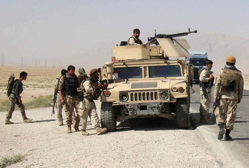 Afghan security forces prepare to check on reports of a possible ambush by the Taliban on the Baghlan-Kunduz highway