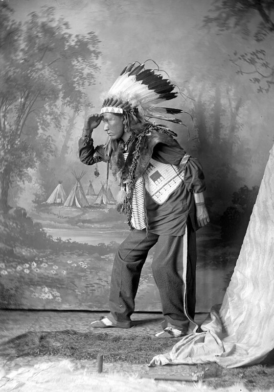 Unidentified Native American male, possibly Dakota or Arapahoe, posed with hand at forehead, 1880s